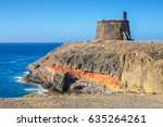 Small photo of Castle Castillo de las Coloradas on cliff in Playa Blanca, Lanzarote, Canary Islands, Spain