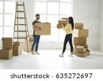 young couple in love unpacking... | Shutterstock . vector #635272697