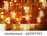 top of wood table with party... | Shutterstock . vector #635297591