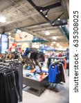 Small photo of Blurred image interior of sports and fitness clothing store in America. Activewear shop, famous fashion brand worldwide of athletic shoes, gear and apparel with mannequins. Healthy lifestyle concept.