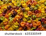 colored pasta in the form of a... | Shutterstock . vector #635330549