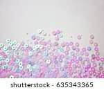 Opalescent Sequins On A White...