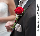 red rose on the clothes of the... | Shutterstock . vector #63534427
