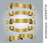 set of golden ribbons on gray... | Shutterstock .eps vector #635349719