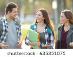front view of three students... | Shutterstock . vector #635351075