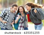 front view of three excited... | Shutterstock . vector #635351255