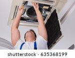 worker repairing ceiling air...   Shutterstock . vector #635368199