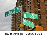 Harlem street intersection at Lenox Avenue and West 135 st in Manhattan, New York City.