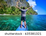 a man standing on boat at sunny ... | Shutterstock . vector #635381321