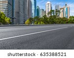 empty asphalt road front of... | Shutterstock . vector #635388521