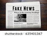 daily newspaper showing 'fake... | Shutterstock . vector #635401367