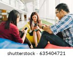 three asian college students or ... | Shutterstock . vector #635404721