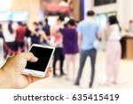 man use mobile phone  blur of... | Shutterstock . vector #635415419