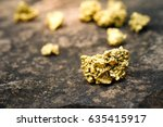 A lump of gold on a stone floor - stock photo