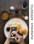 man hand taking photo steak... | Shutterstock . vector #635426711