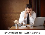 businessman stressed out while... | Shutterstock . vector #635435441