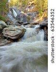 waterfall on north urals | Shutterstock . vector #63546352