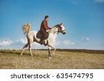 Man Riding On Horse