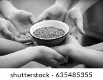 Poor People Holding Bowl With...