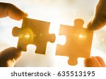 two hands trying to connect... | Shutterstock . vector #635513195