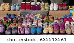 Small photo of Cute knitted baby booties in bright wool colors on display at open air spring flea market in Eching, Bavaria, Germany.