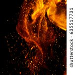 flame of fire with sparks on a... | Shutterstock . vector #635517731