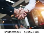 Bussines Partners Handshakes I...