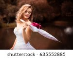 beautiful blond bride in white... | Shutterstock . vector #635552885