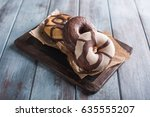 chocolate donuts on a blue... | Shutterstock . vector #635555207