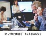 business man having an... | Shutterstock . vector #635560019