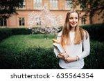 a portrait of a mixed race... | Shutterstock . vector #635564354