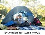kids using laptop in the tent... | Shutterstock . vector #635579921