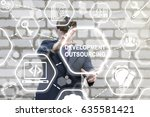 Small photo of Outsourcing Development VR Service Web Design Workforce Freelance Partnership Global Business Industry Concept. Man in virtual reality glasses touched developing outsource on touch screen.