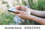 female hands using tablet on... | Shutterstock . vector #635615441
