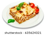 portion of tasty lasagna... | Shutterstock . vector #635624321