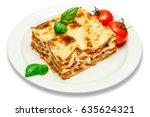 portion of tasty lasagna... | Shutterstock . vector #635624321