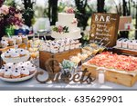 candy bar. white wedding cake... | Shutterstock . vector #635629901