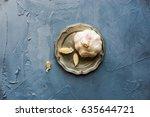 garlic cloves and garlic bulb...   Shutterstock . vector #635644721
