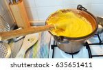 yellow polenta cooked in the... | Shutterstock . vector #635651411