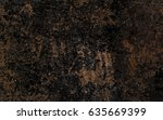 grunge background in dark brown.... | Shutterstock . vector #635669399