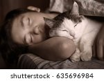 Stock photo teen boy sleep with cat in bed hug close up photo 635696984