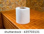 toilet paper on the tile
