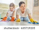 happy family cleans the room.... | Shutterstock . vector #635719205