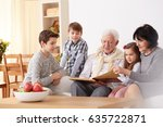 grandparents showing family... | Shutterstock . vector #635722871