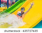 father and son on a water slide ... | Shutterstock . vector #635727635