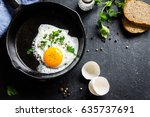 fried egg. close up view of the ... | Shutterstock . vector #635737691
