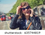 using cellphone with defocused... | Shutterstock . vector #635744819