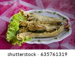 Small photo of Fried Sheatfishes or Siluridae fresh river fish with garlic and pepper severe with vegetable in local restuarant of thailand