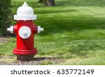red and white fire hydrant on...