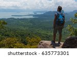 hiker stay on a cliff  | Shutterstock . vector #635773301